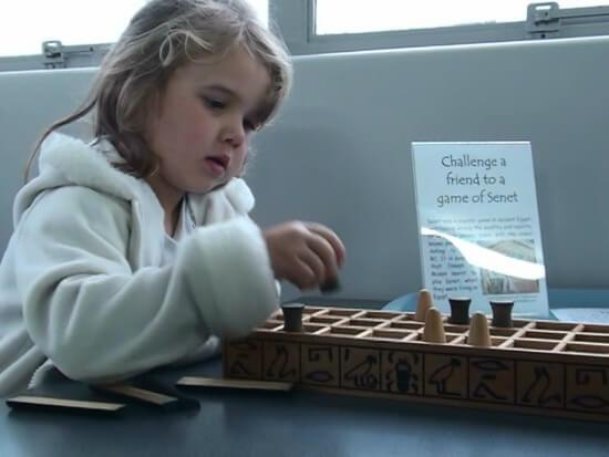 Playing a game of Senet at Bibleworld, Rotorua