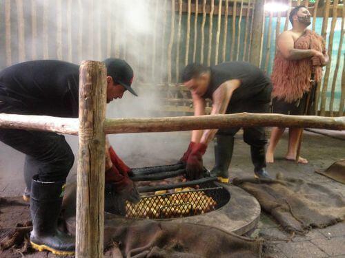 Tamaki Māori Village hangi being uplifted