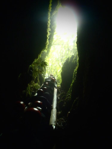Ascending out of Footwhistle Cave, Waitomo, New Zealand
