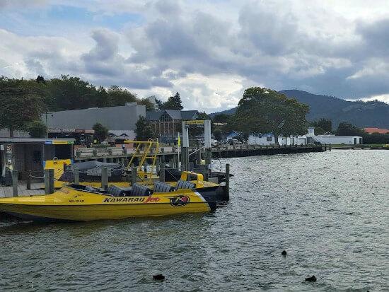 A Katoa Lake Rotorua boat at anchor. That's Mt Ngongotaha to the right.
