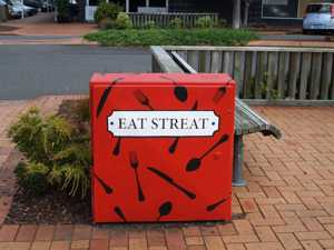 Rotorua Restaurants - Eat Streat Sign painted onto power box.