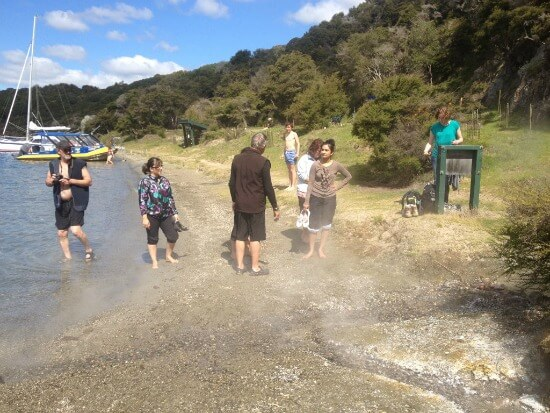 Tarawera Water Taxi Eco Tour party on Hot Water Beach