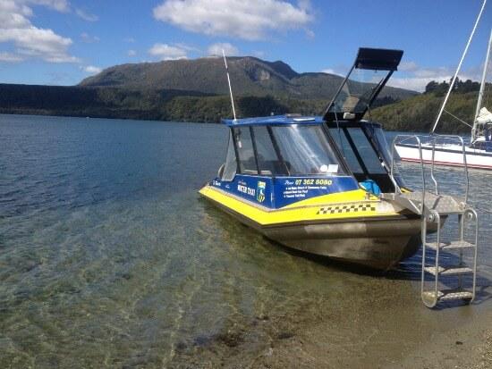 Lake Tarawera Water Taxi with Mt Tarawera as a backdrop