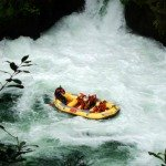 White water rafting Rotorua - Raft disappearing into the water